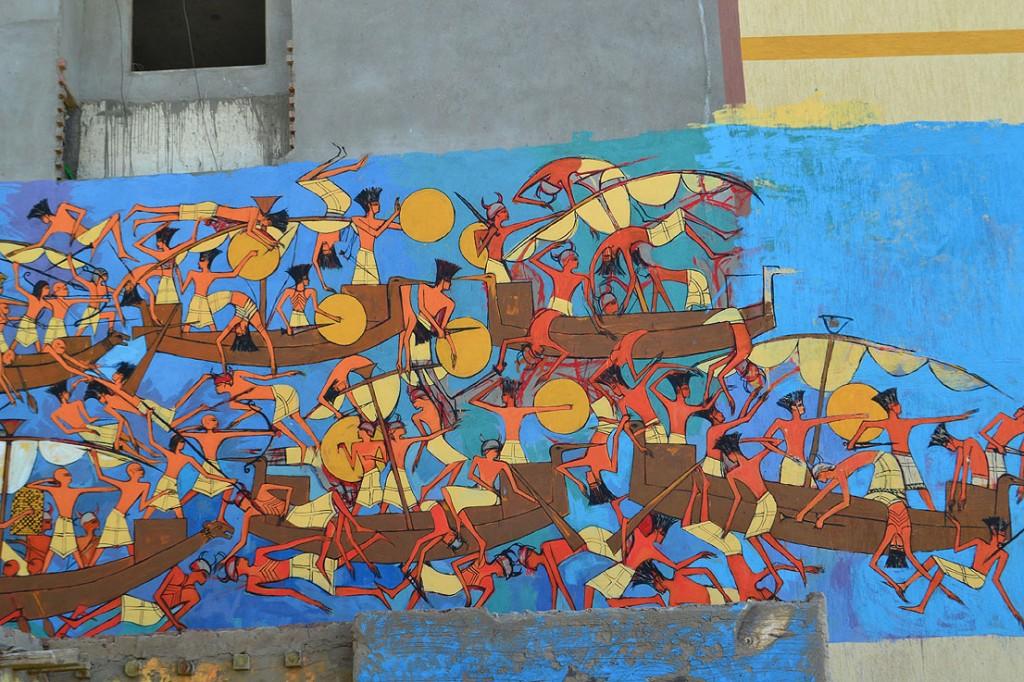 Artist Alaa Awad paints a mural.